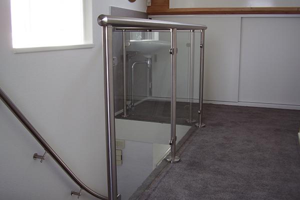 Trapwerk - RVS trapleuning en balustrade